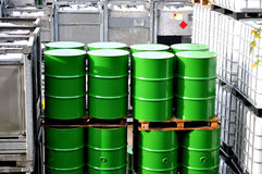 Chemical warehouse. Oil drums and chemical storage bins in a warehouse Royalty Free Stock Photography