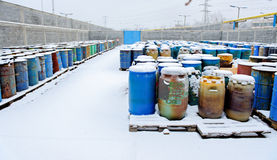Chemical waste dump with a lot of barrels stock image