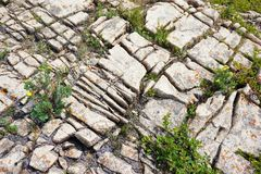 Chemically weathered cracks in limestone. Aerial view of limestone lappies or cracks chemically weathered from acidic rainfall.  The calcium carbonate and Stock Photos