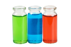Chemicals. Colored liquid transparent chemicals in glass bottles Royalty Free Stock Photos