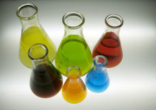 Chemicals in Flasks. Different colored chemicals in Erlenmeyer flasks Royalty Free Stock Photos