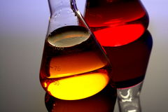 Chemicals in glass flask Royalty Free Stock Images