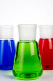 Chemicals in Laboratory Glassware. 3 colors  chemicals in laboratory glassware Stock Images