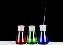 Chemicals in Laboratory Glassware on Black Stock Images