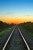 Chemin de fer dans le coucher du soleil Photo stock