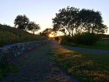 Chemin de Maine dans le coucher du soleil Images stock