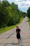 Chemin de marathon de gain de garçon Images libres de droits