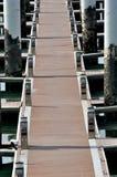 Chemin de panneau sur le dock Photos stock