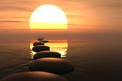 Chemin de zen des pierres dans le coucher du soleil Photographie stock