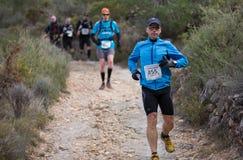Chemin dur de montagne de marathon, s'élevant Photos stock