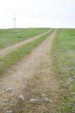 Chemin en rut dans la prairie Photos libres de droits