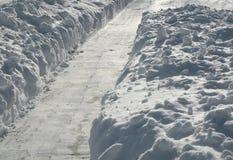 Chemin pellé dans la neige Photos libres de droits