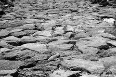Chemin rocheux - noir et blanc Photographie stock