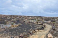 Chemin volcanique fait par des roches photo libre de droits