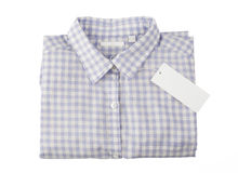Chemise de plaid bleue avec l'étiquette Photos stock