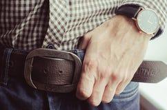 Chemise, jeans, fond humain de main Photos libres de droits