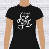 Chemise noire avec amour vous message et coeur à ailes Photographie stock