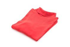 chemise T-shirt plié sur le blanc photographie stock libre de droits