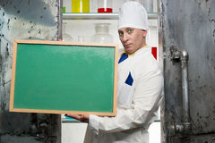 Chemist with blackboard Stock Image