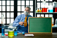 Chemist with blackboard Royalty Free Stock Image