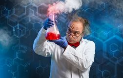 Chemist carefully oversees his experiment stock photography