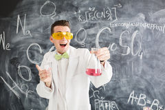 Chemist carries chemistry experiment in laboratory. Royalty Free Stock Images