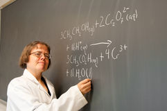 Chemist at the chalkboard royalty free stock images
