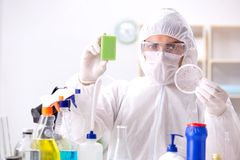 The chemist checking the quality of bathroom supplies Royalty Free Stock Photography