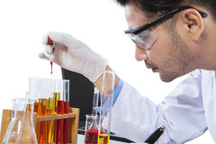 Chemist with chemical liquid Stock Images