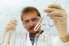 Chemist conducts research of product Stock Photo
