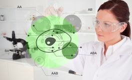 Chemist examining green cell interface Royalty Free Stock Image