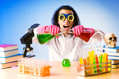 Chemist experimenting with solutions Royalty Free Stock Photo
