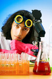 Chemist   experimenting with solutions Royalty Free Stock Image