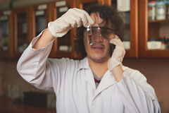 Chemist found new cure. Young chemist found cure in lab and calling Stock Image