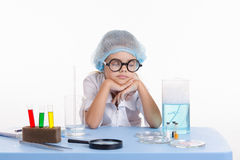 Chemist girl fell asleep during the lesson Stock Images