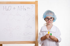 Chemist girl in points and with the tubes at board Stock Photo