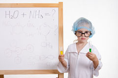 Chemist girl in points and with two tubes at board Stock Photo