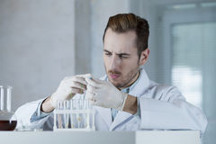 Chemist in the gloves working with reagents Stock Photo