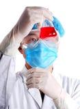 Chemist holding flask Stock Photo