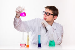 Chemist looks at the glass in the lab stock image