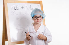 Chemist with a marker at the blackboard Royalty Free Stock Image