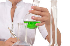 Chemist mixes the liquid in the tubes Royalty Free Stock Photography
