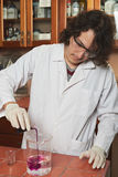 Chemist mixing colour reagents Royalty Free Stock Image