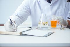 The chemist mixing perfumes in the lab Royalty Free Stock Images