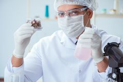 The chemist mixing perfumes in the lab Stock Image