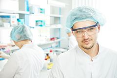 Chemist researchers workers in laboratory Stock Photo