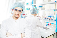 Chemist researchers workers in laboratory Royalty Free Stock Photos