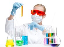 Chemist in respirator holds a vial Royalty Free Stock Images