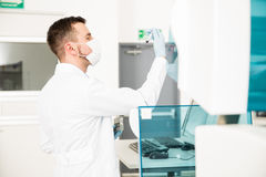 Chemist running blood tests in a lab Stock Images