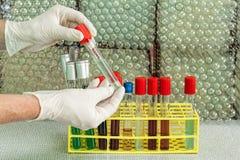 Chemist showing test tube Stock Image